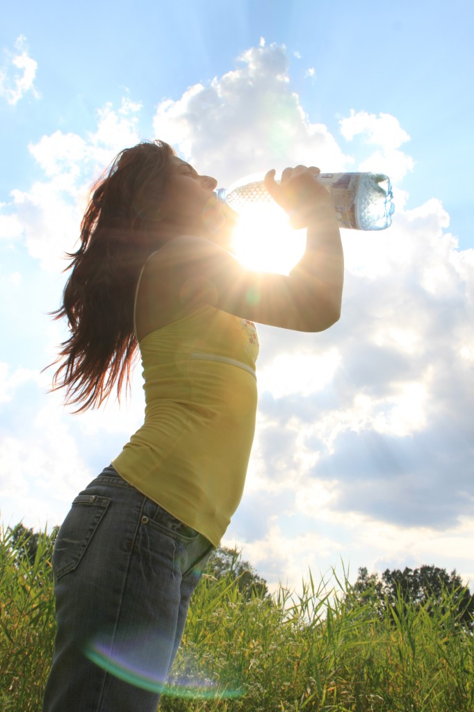 Young-Woman-Drinking-Water_Summer-Sun